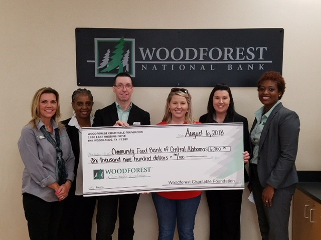 Community Food Bank of Central Alabama received a $6,900 donation from WCF.