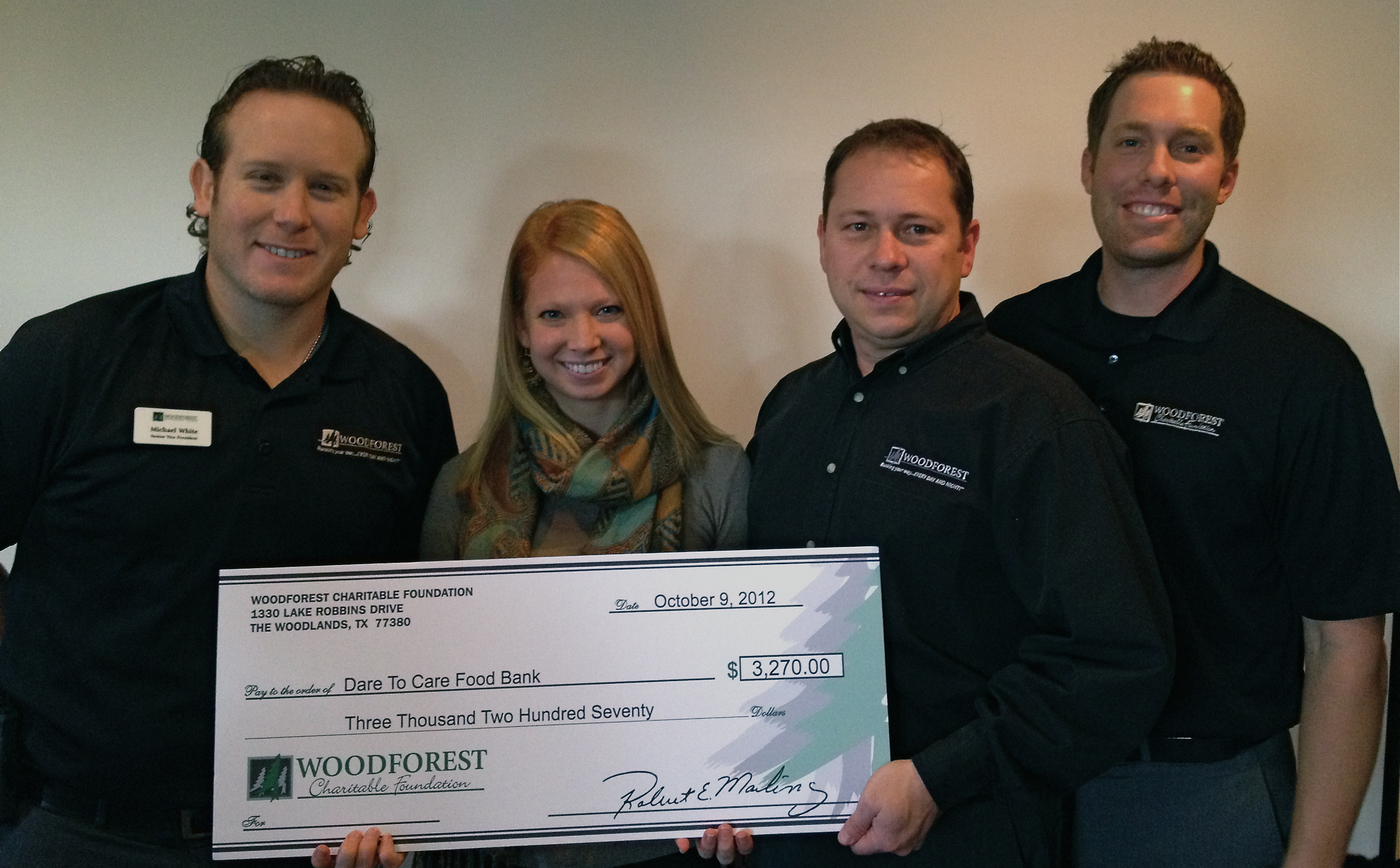 Dare to Care Food Bank receives $420 donation from Woodforest Charitable Foundation.