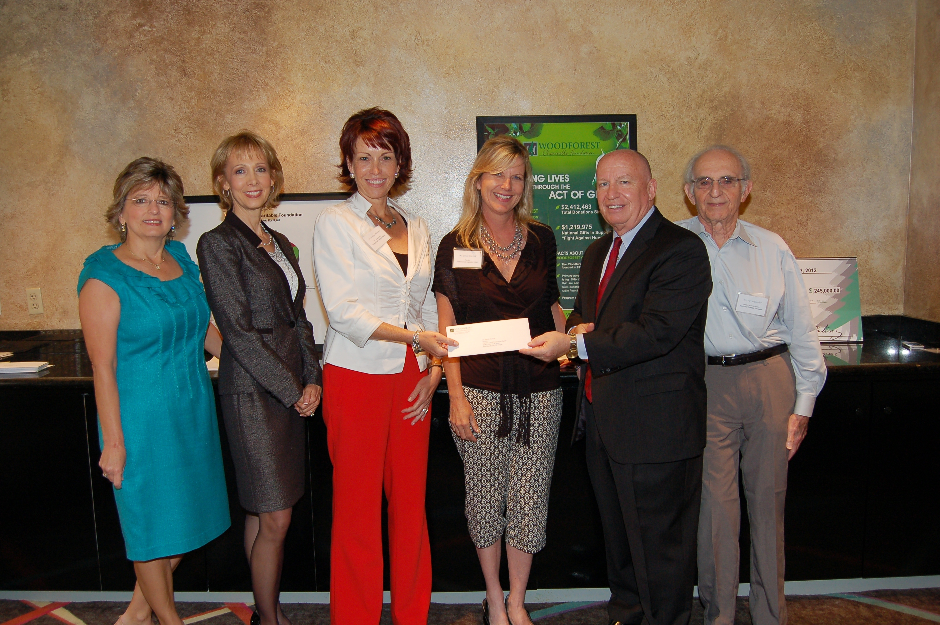 Panther Creek Inspiration Ranch receives $2,500 donation from Woodforest Charitable Foundation.