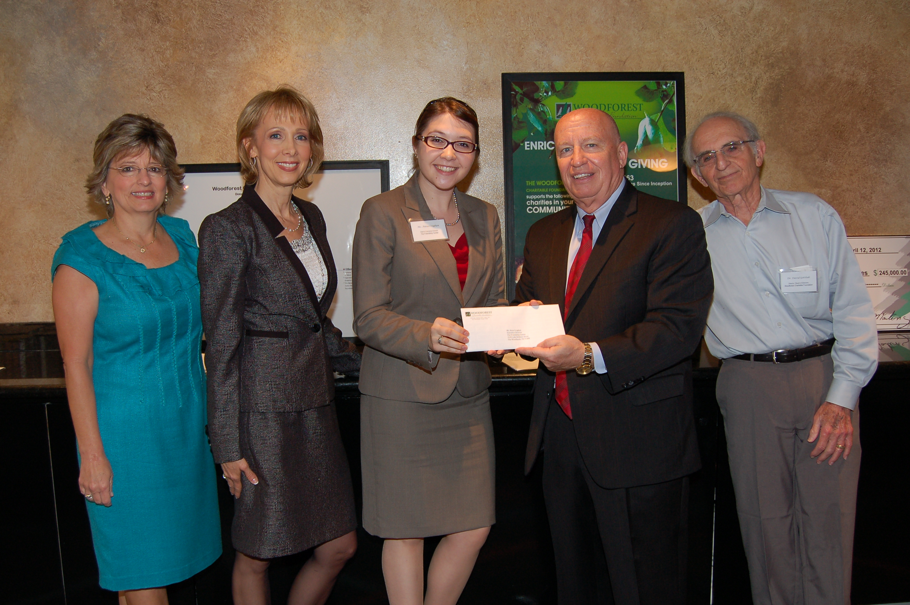 Friendship Center receives $5,000 donation from Woodforest Charitable Foundation.